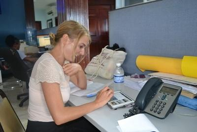 A Projects Abroad Journalism volunteer conducts research for a news story on one of our internships abroad in Jamaica