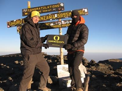 Two volunteers enjoying an adventure holiday summit Mount Kilimanjaro
