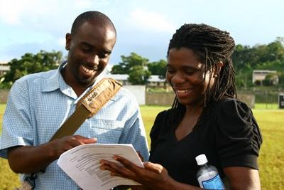 A staff member guiding a volunteer
