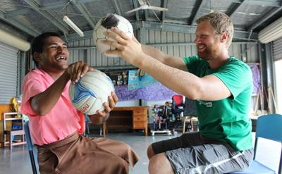 A volunteer runs a physiotherapy session in Samoa on a voluntourism experience abroad