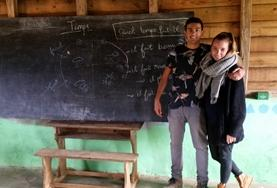 Two volunteers practise their Malagasy skills after their language lessons in Madagascar.