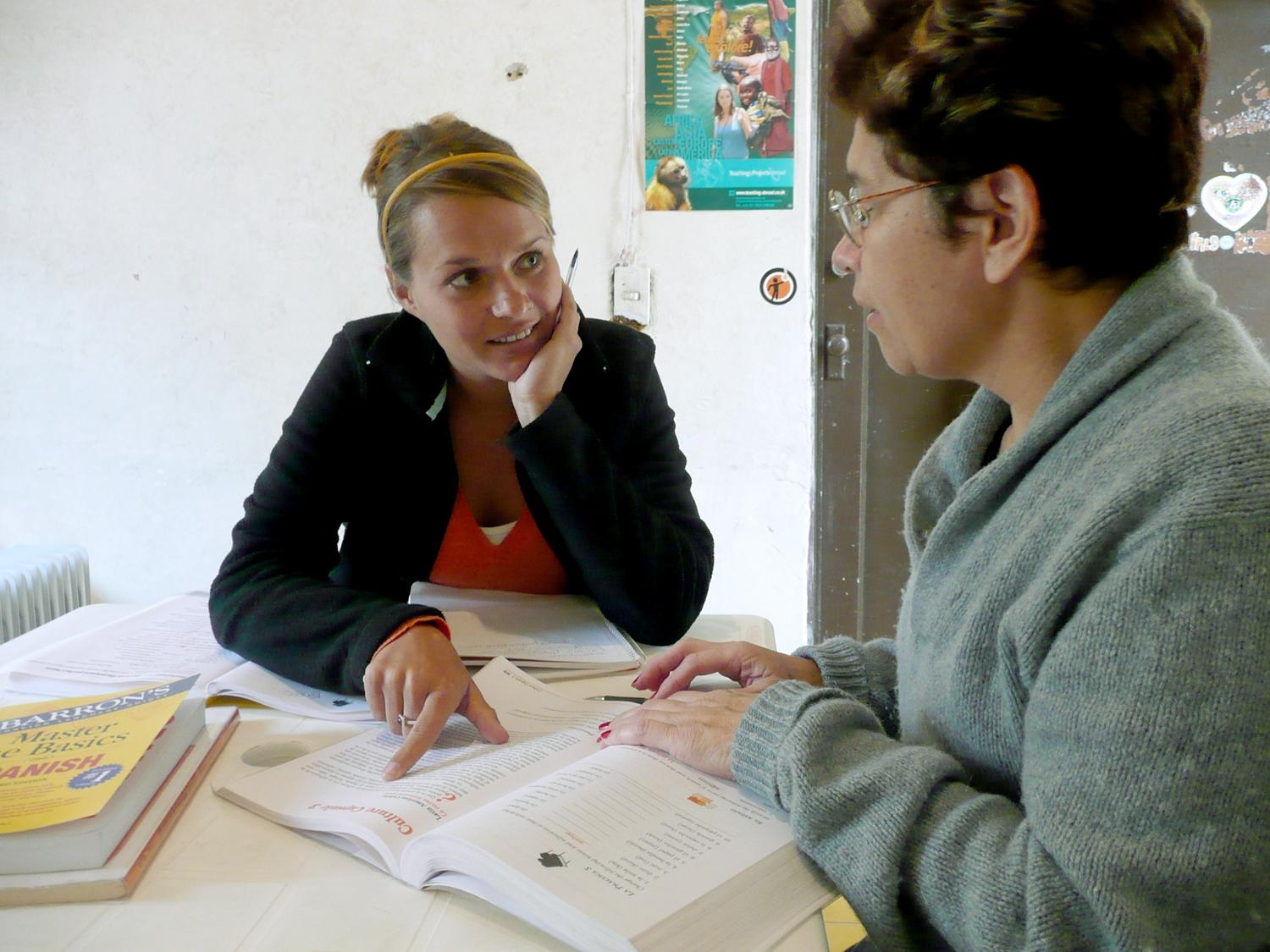 A volunteer listens intently to her tutor during her Arabic language course in Morocco.