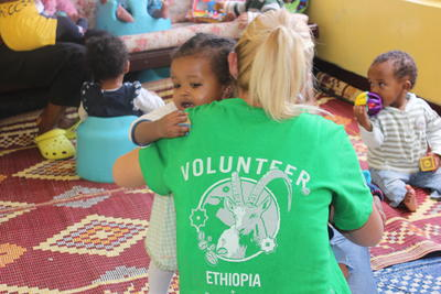 Projects Abroad volunteer enjoys a special moment with a child at her placement in Ethiopia