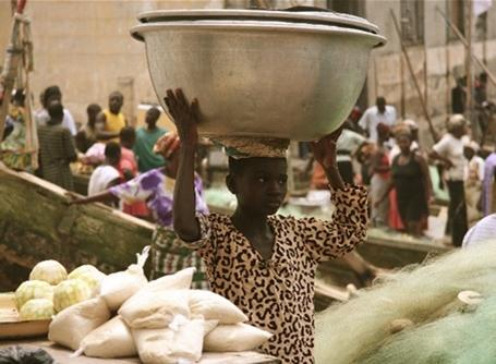 A girl at a market in Ghana