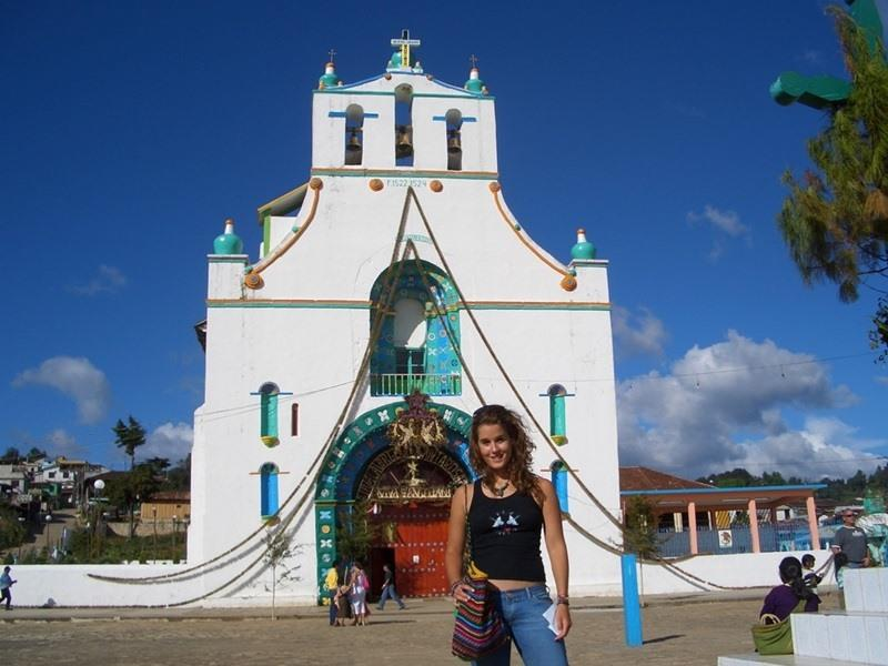 A gap year volunteer in front of a church in Mexico