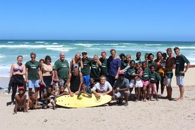 A group of volunteers and children at the beach in Cape Town, South Africa