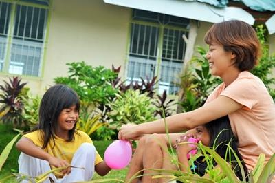 A volunteer busy teaching a child in a care project in the Philippines