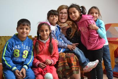 A group of children and a volunteer in Romania