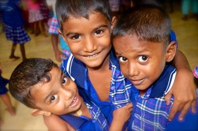 Three children at a Sri Lanka care centre where Projects Abroad works pose for the camera