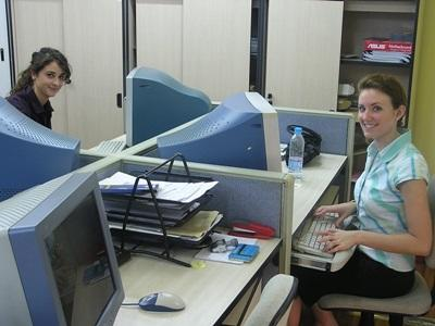 Business volunteers at their desks in China