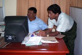 Two employees in the marketing sector of a Sri Lankan business explain their roles to an intern.