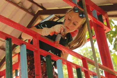 A Projects Abroad Care volunteer paints during her project in Cambodia
