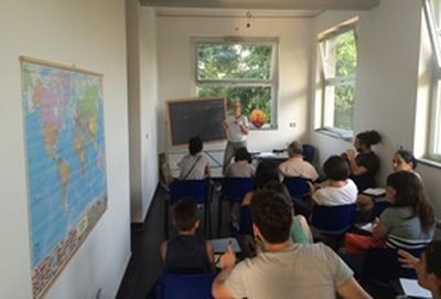 Care volunteers at our Refugee Project in Italy teaching an English class for refugees in the area.