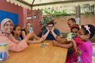 Projects Abroad volunteers playing with children at a Care placement in Morocco