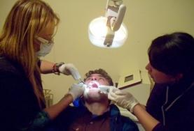 A local dentist demonstrates a dental problem to a Dentistry Elective intern in an Argentinian hospital.