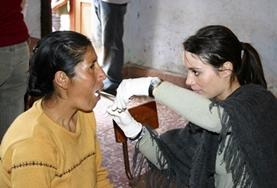 A dentistry student volunteering in Peru examines a patient's teeth as part of her elective work.