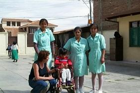 Medicine Elective interns work together with local staff to treat a child with disabilities in Bolivia.