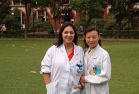 A Medicine Elective intern and a local doctor stand outside our placement hospital in China.