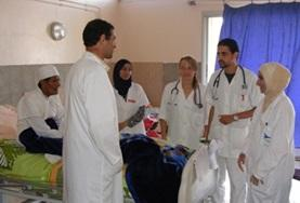 Medicine students working towards their elective course credits in Morocco listen as local doctors explain a treatment technique.