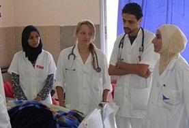 A Midwifery Elective intern listens as local medical staff discuss medical practices at a hospital in Morocco.
