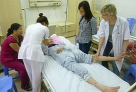 A Nursing student assists local staff in a hospital in Vietnam as part of her elective placement abroad.