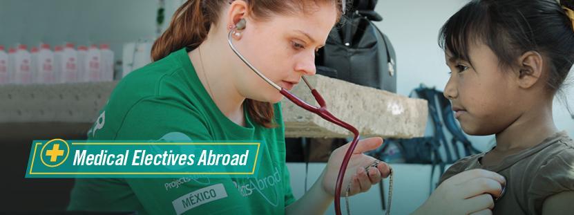 Medical Elective volunteer examines a patient