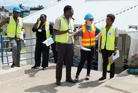 A Disaster Management volunteer coordinates an emergency evacuation plan at her placement in Jamaica.