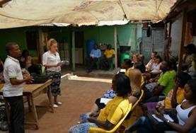 A Human Rights volunteer gives a talk on women's rights to a group of women in Ghana.