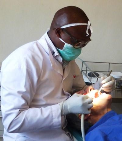 A dentistry volunteer performs a routine check-up in Kenya.
