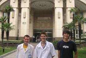 Dentistry interns stand outside their internship placement hospital in China.