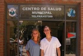 Two Medicine interns stand outside their volunteer placement hospital in Argentina.
