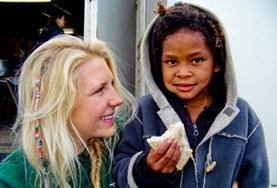 A Nutrition volunteer doing her internship in South Africa talks to a child about the importance of healthy eating.