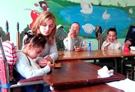 An Occupational Therapy intern volunteering in Morocco spends time working with disabled children to help with rehabilitation.