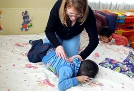 A Physiotherapy intern treats a local child with disabilities at our volunteer placement in Mongolia.