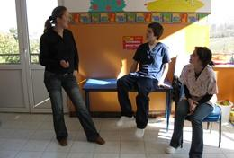 Physiotherapy interns volunteering in Romania listen as a local physiotherapist teaches them about therapy techniques.