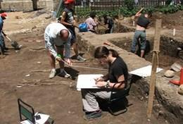 A professional archaeologist records details about a dig site at our volunteer placement in Transylvania, Romania.