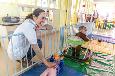 A Projects Abroad volunteer plays with the children at a nutrition center in Cochabamba