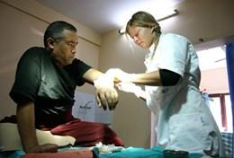 A professional acupuncturist uses acupuncture to treat a patient in a local hospital as part of her volunteer work in Nepal.