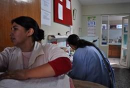 A professional nurse volunteering at a hospital in Peru assists with the daily work of local doctors and other medical health professionals.