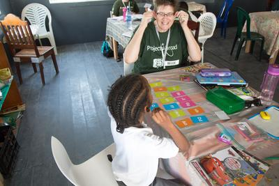 A Projects Abroad volunteer teaching a young child in Belize