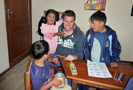 A professional special educational needs teacher gives a lesson to a group of disabled children in Bolivia.