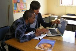 A professional Business volunteer goes through the business plan of a local entrepreneur at one of our volunteer placements.