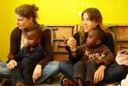 High School Special volunteers spend time with local children in Kenya, helping with their education and development.