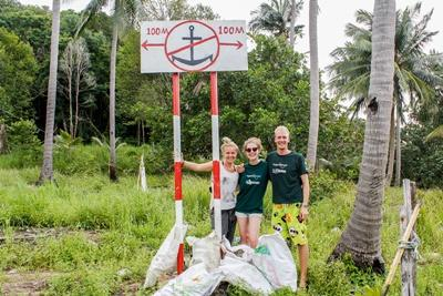 Staff member and volunteers with the trash they picked up on a community clean up in Cambodia
