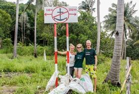 High School Special Conservation & Community volunteers stand in front of the rubbish they collected during a beach clean-up in Cambodia.