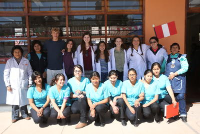 High School Special Medicine volunteers pose with teachers and nurses following a medical outreach at a primary school in Cusco