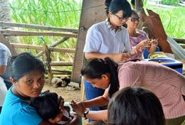A high school student assists at a healthcare screening as part of her short-term Public Health internship in the Philippines.