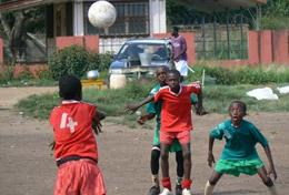Children in Ghana playing football at our volunteer Sports placement for high school students.