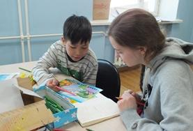 A volunteer works with a local child under the guidance of a qualified social worker during her Social Work internship in Mongolia.