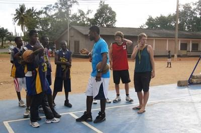 Basketball volunteers coach local children during a sports lesson in Ghana.